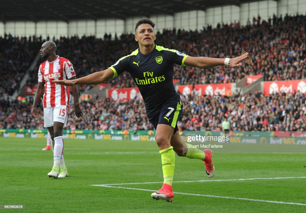 Alexis Sanchez celebrates scoring the 3rd Arsenal goal during the Premier League match between Stoke City and Arsenal at Bet365 Stadium on May 13, 2017 in Stoke on Trent, England.