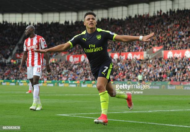 Alexis Sanchez celebrates scoring the 3rd Arsenal goal during the Premier League match between Stoke City and Arsenal at Bet365 Stadium on May 13...