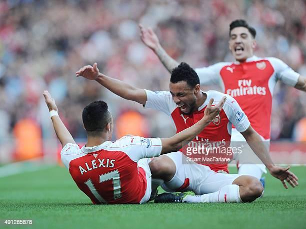Alexis Sanchez celebrates scoring the 3rd Arsenal goal with Francis Coquelin during the Barclays Premier League match between Arsenal and Manchester...