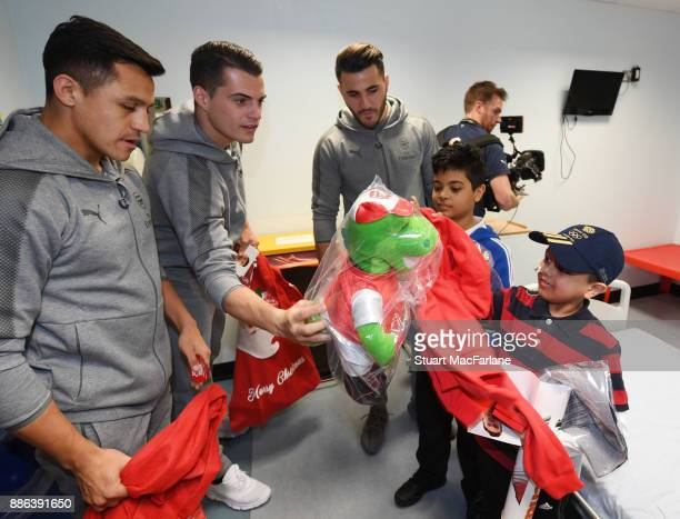 Alexis Sanchez Granit Xhaka and Sead Kolasinac of Arsenal visit the Whittington Hospital on December 5 2017 in London England