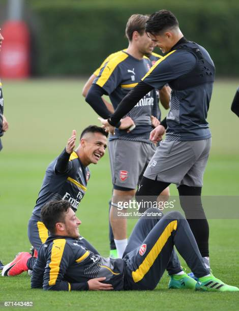 Alexis Sanchez Mesut Ozil and Granit Xhaka of Arsenal during a training session at London Colney on April 22 2017 in St Albans England