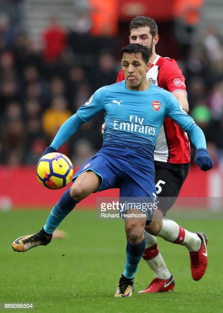 Alexis Sanchez of Arsenaal and Jack Stephens of Southampton during the Premier League match between Southampton and Arsenal at St Mary's Stadium on...