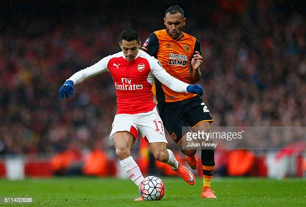 Alexis Sanchez of Arsenal and Ahmed Elmohamady of Hull City compete for the ball during the Emirates FA Cup fifth round match between Arsenal and...