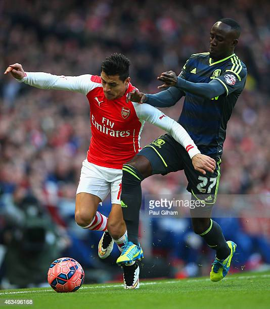 Alexis Sanchez of Arsenal and Albert Adomah of Middlesbrough battle for the ball during the FA Cup fifth round match between Arsenal and...