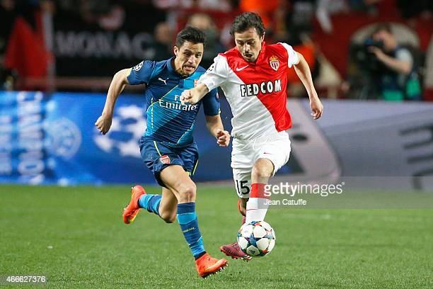 Alexis Sanchez of Arsenal and Bernardo Silva of Monaco in action during the UEFA Champions League round of 16 match between AS Monaco FC and Arsenal...