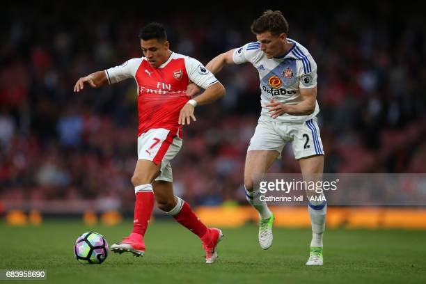 Alexis Sanchez of Arsenal and Billy Jones of Sunderland during the Premier League match between Arsenal and Sunderland at Emirates Stadium on May 16...