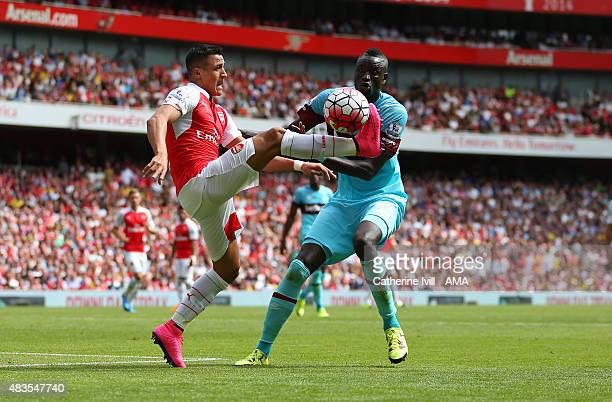 Alexis Sanchez of Arsenal and Cheikhou Kouyate of West Ham United during the Barclays Premier League match between Arsenal and West Ham United at...