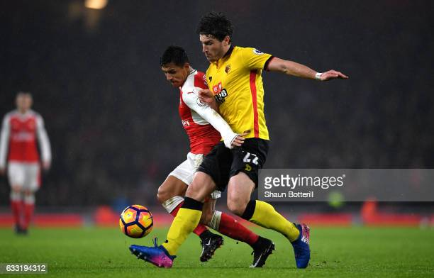 Alexis Sanchez of Arsenal and Daryl Janmaat of Watford compete for the ball during the Premier League match between Arsenal and Watford at Emirates...