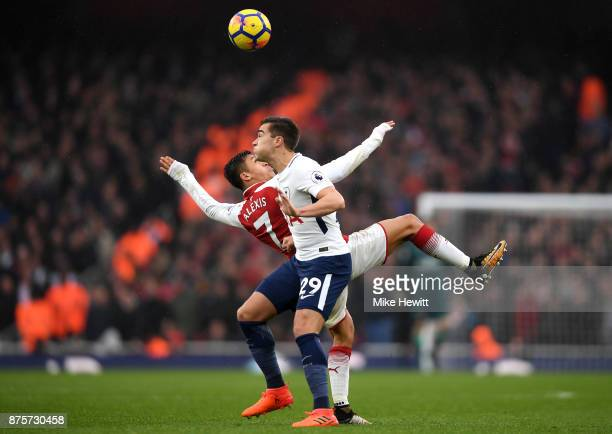Alexis Sanchez of Arsenal and Harry Winks of Tottenham Hotspur in action during the Premier League match between Arsenal and Tottenham Hotspur at...