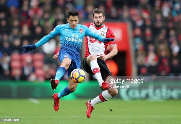 Alexis Sanchez of Arsenal and Jack Stephens of Southampton battle for the ball during the Premier League match between Southampton and Arsenal at St...