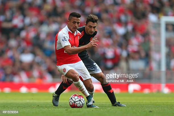 Alexis Sanchez of Arsenal and Matteo Darmian of Manchester United during the Barclays Premier League match between Arsenal and Manchester United at...