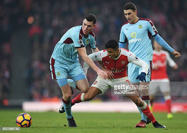 Alexis Sanchez of Arsenal and Michael Keane of Burnley compete for the ball during the Premier League match between Arsenal and Burnley at the...