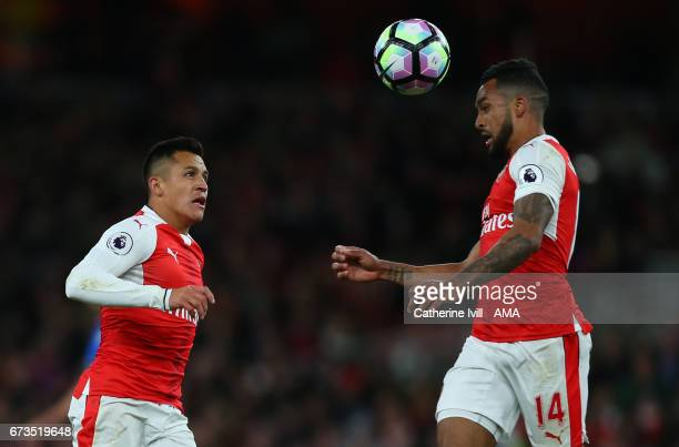 Alexis Sanchez of Arsenal and Theo Walcott of Arsenal during the Premier League match between Arsenal and Leicester City at Emirates Stadium on April...