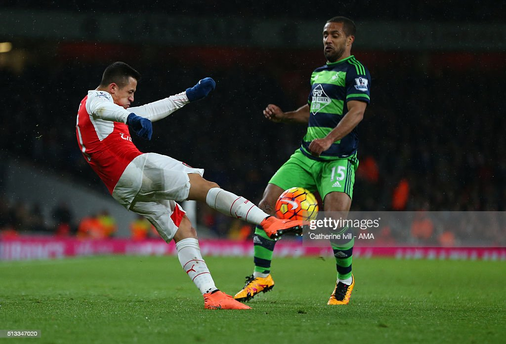 Alexis Sanchez of Arsenal and Wayne Routledge of Swansea City during the Barclays Premier League match between Arsenal and Swansea City at the Emirates Stadium on March 02, 2016 in London, England.