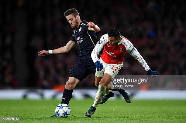 Alexis Sanchez of Arsenal battles for the ball with Ivo Pinto of Dinamo Zagreb during the UEFA Champions League match between Arsenal FC and GNK...