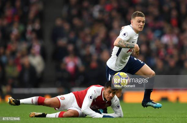 Alexis Sanchez of Arsenal battles for the ball with Kieran Trippier of Tottenham Hotspur during the Premier League match between Arsenal and...