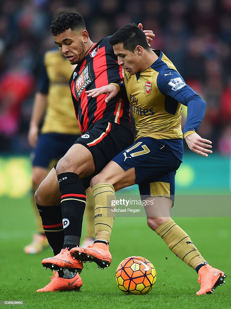 Alexis Sanchez of Arsenal battles with <a gi-track='captionPersonalityLinkClicked' href=/galleries/search?phrase=Joshua+King+-+Soccer+Player&family=editorial&specificpeople=15368781 ng-click='$event.stopPropagation()'>Joshua King</a> of Bournemouth during the Barclays Premier League match between A.F.C. Bournemouth and Arsenal at the Vitality Stadium on February 7, 2016 in Bournemouth, England.