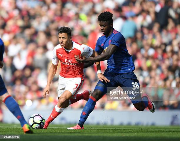 Alexis Sanchez of Arsenal breaks past Axel Tuanzebe of Man United during the Premier League match between Arsenal and Manchester United at Emirates...