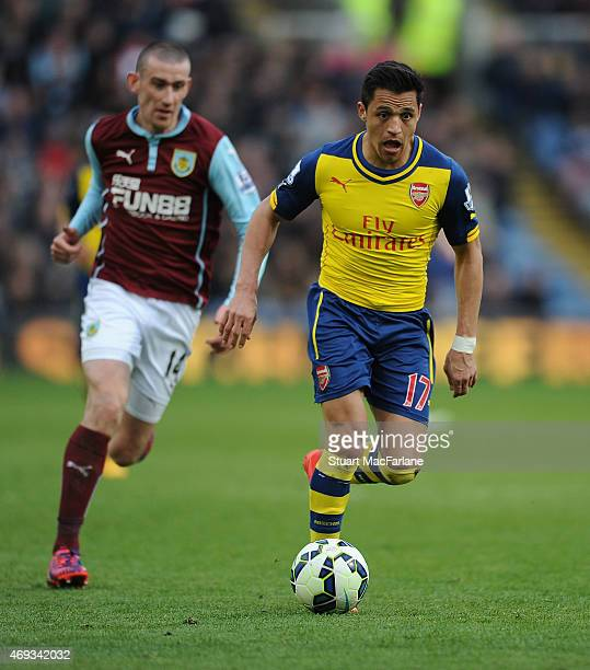 Alexis Sanchez of Arsenal breaks past David Jones of Burnley during the Barclays Premier League match between Burnley and Arsenal at Turf Moor on...