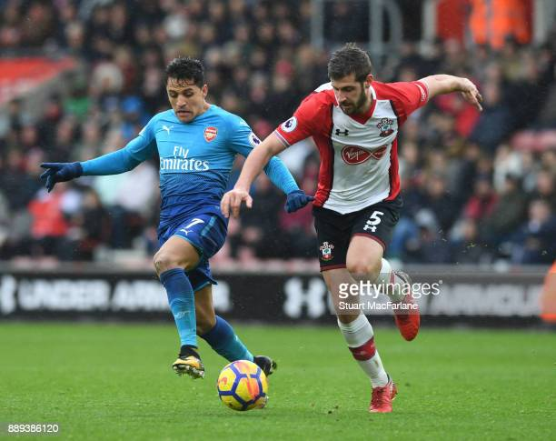 Alexis Sanchez of Arsenal breaks past Jack Stephens of Southampton during the Premier League mat ch between Southampton and Arsenal at St Mary's...