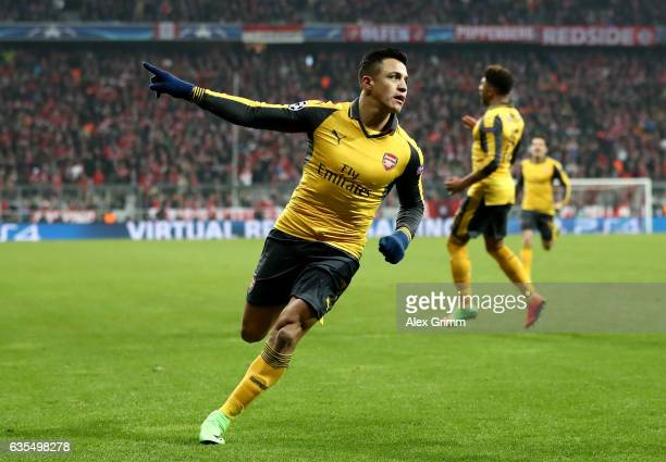 Alexis Sanchez of Arsenal celebrates after he scores the equalizing goal during the UEFA Champions League Round of 16 first leg match between FC...