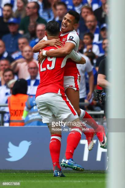 Alexis Sanchez of Arsenal celebrates after scoring a goal to make it 10 during the Emirates FA Cup Final match between Arsenal and Chelsea at Wembley...