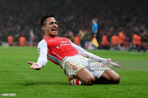 Alexis Sanchez of Arsenal celebrates after scoring his team's second goal during the UEFA Champions League Group D match between Arsenal and Borussia...