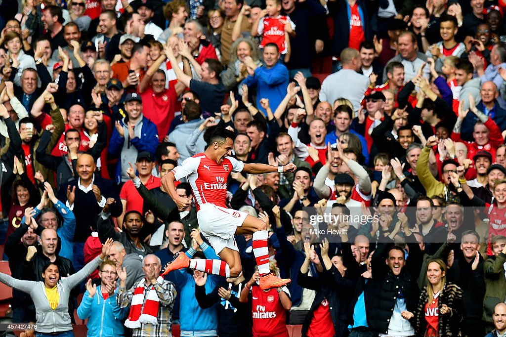 Alexis Sanchez of Arsenal celebrates after scoring the opening goal during the Barclays Premier League match between Arsenal and Hull City at Emirates Stadium on October 18, 2014 in London, England.
