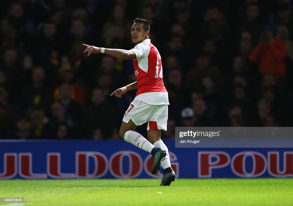 Alexis Sanchez of Arsenal celebrates as he scores their first goal during the Barclays Premier League match between Watford and Arsenal at Vicarage Road on October 17, 2015 in Watford, England.