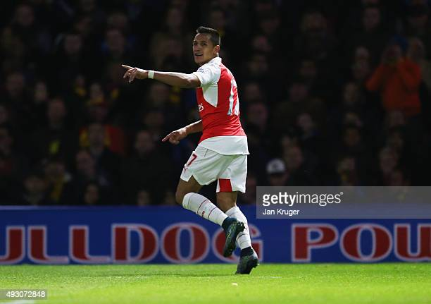Alexis Sanchez of Arsenal celebrates as he scores their first goal during the Barclays Premier League match between Watford and Arsenal at Vicarage...