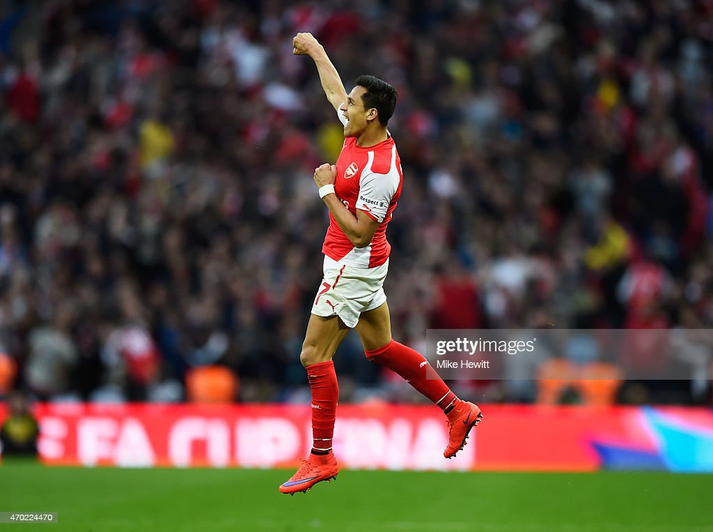 Alexis Sanchez of Arsenal celebrates as he scores their second goal during the FA Cup Semi Final between Arsenal and Reading at Wembley Stadium on April 18, 2015 in London, England.