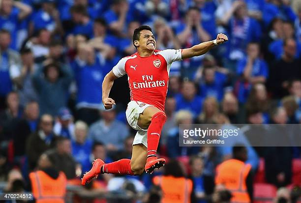 Alexis Sanchez of Arsenal celebrates as he scores their second goal during the FA Cup Semi Final between Arsenal and Reading at Wembley Stadium on...