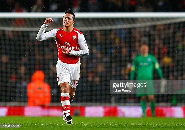 Alexis Sanchez of Arsenal celebrates his goal during the Barclays Premier League match between Arsenal and Queens Park Rangers at Emirates Stadium on...