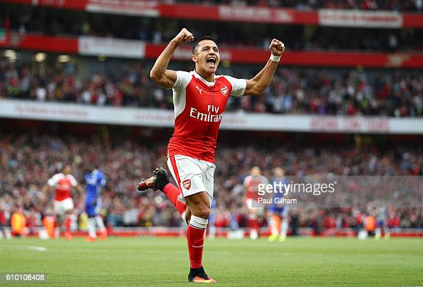Alexis Sanchez of Arsenal celebrates scoring his sides first goal during the Premier League match between Arsenal and Chelsea at the Emirates Stadium...