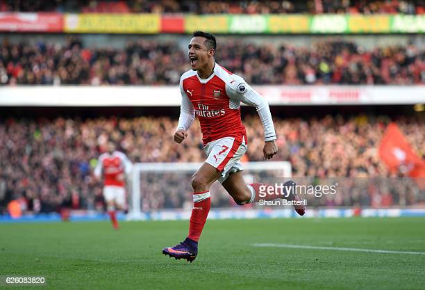 Alexis Sanchez of Arsenal celebrates scoring his sides first goal during the Premier League match between Arsenal and AFC Bournemouth at Emirates...