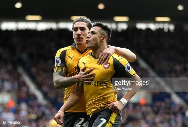 Alexis Sanchez of Arsenal celebrates scoring his sides first goal with Hector Bellerin of Arsenal during the Premier League match between West...