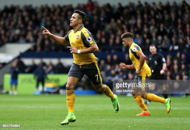 Alexis Sanchez of Arsenal celebrates scoring his sides first goal during the Premier League match between West Bromwich Albion and Arsenal at The...