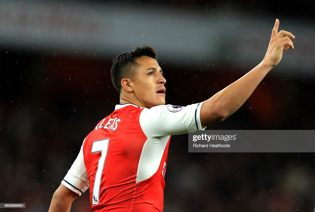 Alexis Sanchez of Arsenal celebrates scoring his sides first goal during the Premier League match between Arsenal and Sunderland at Emirates Stadium on May 16, 2017 in London, England.