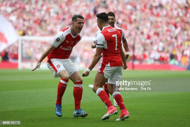 Alexis Sanchez of Arsenal celebrates scoring his sides first goal with Granit Xhaka of Arsenal during the Emirates FA Cup Final between Arsenal and...