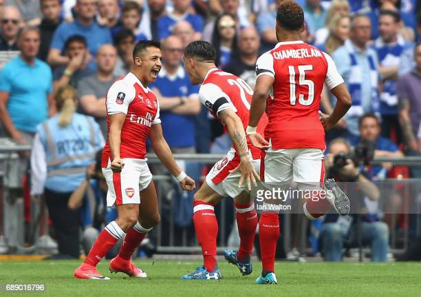 Alexis Sanchez of Arsenal celebrates scoring his sides first goal with his Arsenal team mates during the Emirates FA Cup Final between Arsenal and...