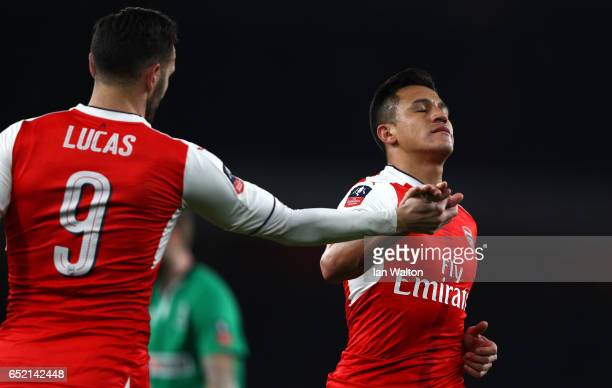 Alexis Sanchez of Arsenal celebrates scoring his sides fourth goal with Lucas Perez of Arsenal during The Emirates FA Cup QuarterFinal match between...