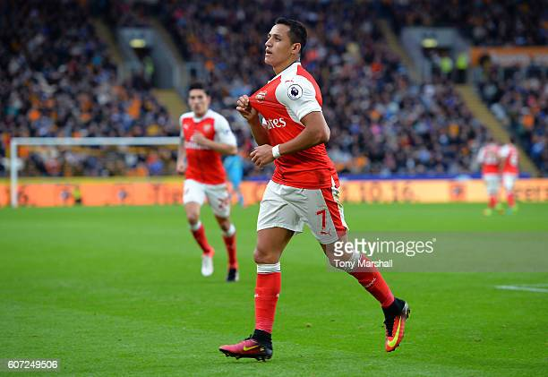 Alexis Sanchez of Arsenal celebrates scoring his sides second goal during the Premier League match between Hull City and Arsenal at KCOM Stadium on...