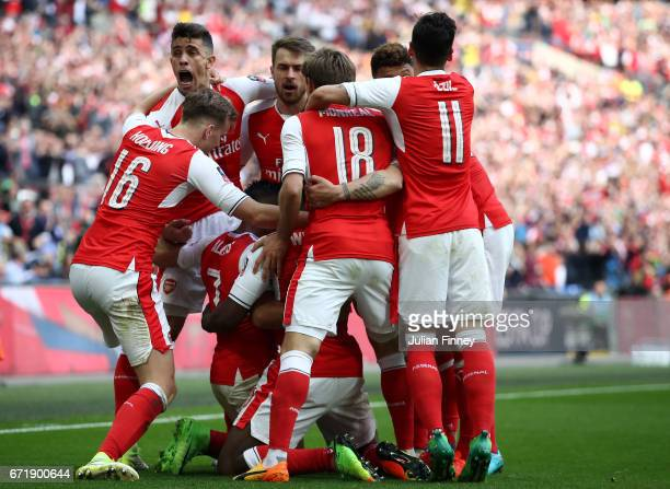 Alexis Sanchez of Arsenal celebrates scoring his side's second goal with his team mates during the Emirates FA Cup SemiFinal match between Arsenal...
