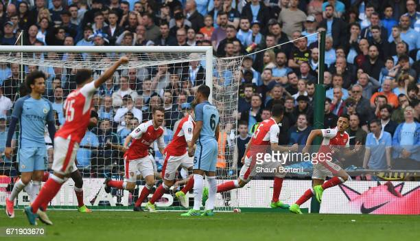 Alexis Sanchez of Arsenal celebrates scoring his side's second goal during the Emirates FA Cup SemiFinal match between Arsenal and Manchester City at...