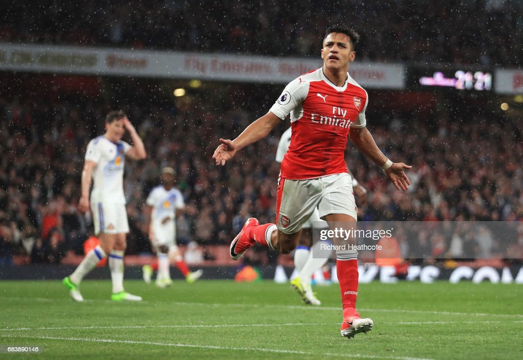 Alexis Sanchez of Arsenal celebrates scoring his sides second goal during the Premier League match between Arsenal and Sunderland at Emirates Stadium on May 16, 2017 in London, England.