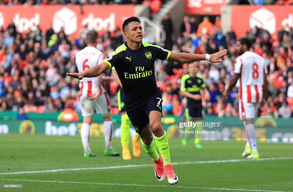 Alexis Sanchez of Arsenal celebrates scoring his sides third goal during the Premier League match between Stoke City and Arsenal at Bet365 Stadium on May 13, 2017 in Stoke on Trent, England.