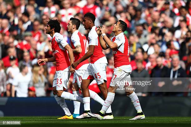 Alexis Sanchez of Arsenal celebrates scoring his team's first goal during the Barclays Premier League match between Arsenal and Watford at Emirates...