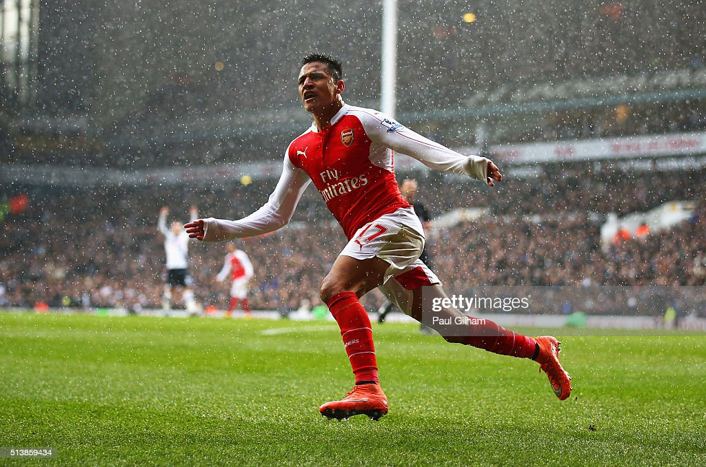 Alexis Sanchez of Arsenal celebrates scoring his team's second goal during the Barclays Premier League match between Tottenham Hotspur and Arsenal at White Hart Lane on March 5, 2016 in London, England.