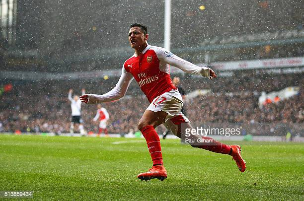 Alexis Sanchez of Arsenal celebrates scoring his team's second goal during the Barclays Premier League match between Tottenham Hotspur and Arsenal at...