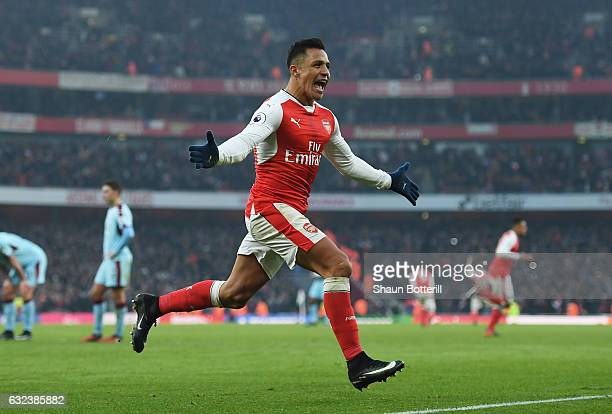 Alexis Sanchez of Arsenal celebrates scoring his team's second goal during the Premier League match between Arsenal and Burnley at the Emirates...
